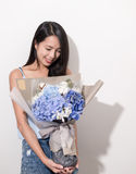 Woman holding flower. Asian young woman Royalty Free Stock Photo