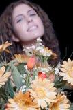 Woman holding flower bouquet Stock Photos