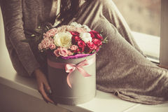 Woman holding a flower bouquet Stock Photo