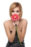 Woman holding a flower in front of her nose Royalty Free Stock Photography