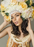 Woman holding flower headpiece Royalty Free Stock Image
