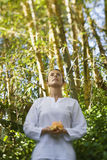 Woman Holding Flower Outdoors Stock Photography