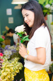 Woman holding flower portrait smiling Royalty Free Stock Image