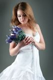 Woman holding a flower Royalty Free Stock Images