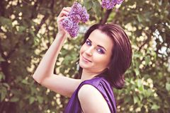 Woman holding a flowering branch in hand Royalty Free Stock Images