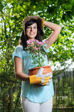 Woman holding a flowerpot Stock Photo