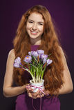 Woman holding flowerpot with crocuses Royalty Free Stock Photos