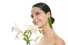 Woman holding flowers. Young woman looking up and holding flowers Royalty Free Stock Photography