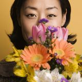Woman holding flowers. royalty free stock photos