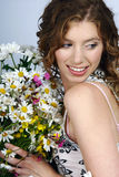 Woman holding flowers Royalty Free Stock Photo