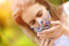 Woman holding flowers Stock Image