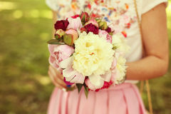 Woman holding flowers bouquet Stock Photo