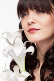 Woman holding flowers in hands in beauty portrait Royalty Free Stock Images