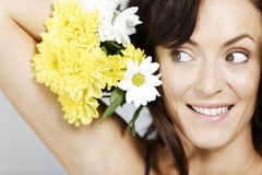 Woman holding flowers Stock Photos