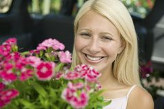 Woman Holding Flowers portrait Royalty Free Stock Photo
