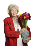 Woman Holding Flowers with smile Stock Photo