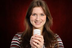 Woman holding an fluorescent light bulb Royalty Free Stock Photos