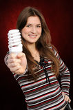Woman holding an fluorescent light bulb Stock Photography