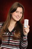 Woman holding an fluorescent light bulb Royalty Free Stock Images