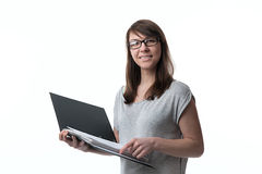 Woman is holding a folder with documents Stock Image