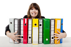Woman holding folders. Stressed woman in the office holding  folders Royalty Free Stock Photos