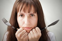 Woman holding fork and knife Stock Photo