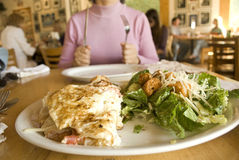 Woman holding fork and knife ready to eat omelet Royalty Free Stock Images
