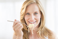 Woman Holding Fork With Pasta At Home Stock Image