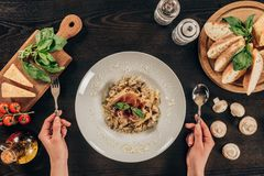 woman holding fork and spoon and going to eat pasta royalty free stock photos