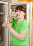 Woman  holding foul food Stock Image