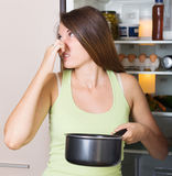 Woman holding foul food Royalty Free Stock Image