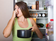 Woman holding foul food Royalty Free Stock Photos