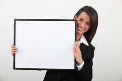 Woman holding a frame Royalty Free Stock Photo