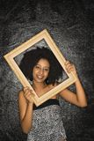 Woman holding frame. Royalty Free Stock Photography