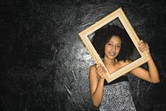 Woman holding frame. Royalty Free Stock Photo