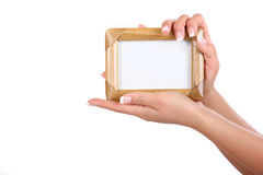 Woman holding frame. Isolated on white Stock Image