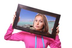 Woman Holding Frame, travel concept Royalty Free Stock Photo