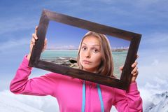 Woman Holding Frame, travel concept Stock Photography