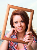 Woman Holding Frame travel concept Stock Image