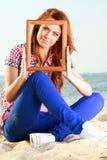 Woman Holding Frame travel concept Stock Photos