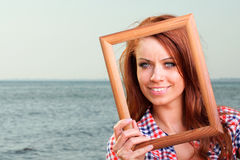 Woman Holding Frame travel concept Stock Photography