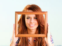 Woman Holding Frame travel concept Royalty Free Stock Images
