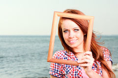 Woman Holding Frame travel concept Stock Images