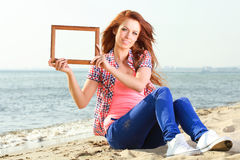 Woman Holding Frame travel concept Stock Photo