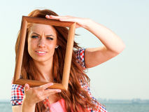 Woman Holding Frame travel concept royalty free stock image