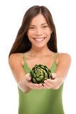 Woman holding fresh artichoke vegetable in hands. Woman holding fresh artichoke globe flower closeup isolated on white background. Asian happy girl showing green stock photos