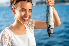 Woman holding fresh fish Stock Photography