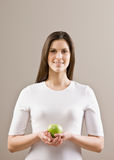 Woman holding fresh green apple Royalty Free Stock Photos