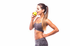 Woman holding fresh green apple. Fitness woman holding fresh green apple Royalty Free Stock Images