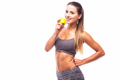 Woman holding fresh green apple. Fitness woman holding fresh green apple Royalty Free Stock Photo